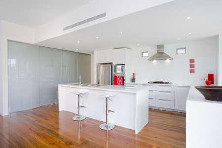 australia landscape: Modern kitchen with stainless steel appliances in Australian mansion
