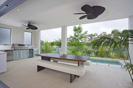 Outdoor entertaining area with swiming pool photo