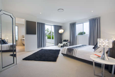 Luxurious master bedroom in mansion photo