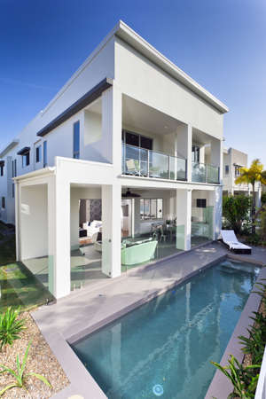 Stylish new house with covered patio and swimming pool Stock Photo - 17686846