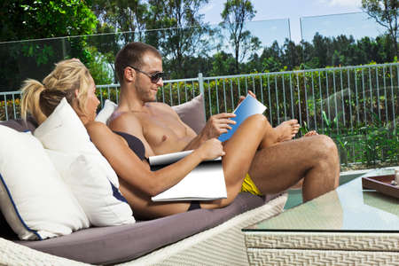 Attractive young couple in backyard patio Stock Photo - 17686860