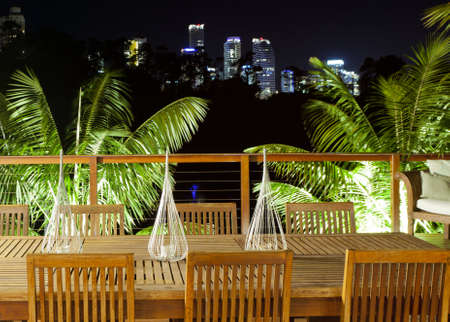 Outdoor entertaining area with beautiful city skyline view photo