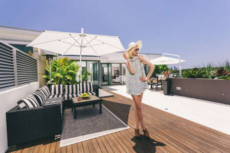 Attractive woman on luxurious penthouse balcony Stock Photo - 18573634