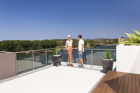 balcony: Attractive couple on luxurious penthouse balcony