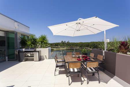 Sunny luxurious penthouse balcony Stock Photo