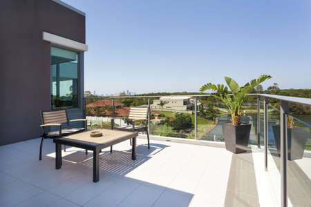 Small balcony overlooking the suburbs photo