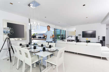 lamp house: Handsome man with champagne bottle in luxury apartment