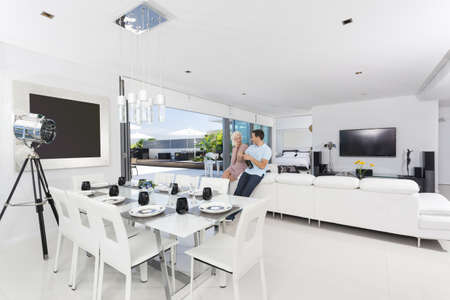 Attractive couple with champagne bottle in luxury apartment