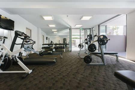 weight machine: Modern gym interior with equipment