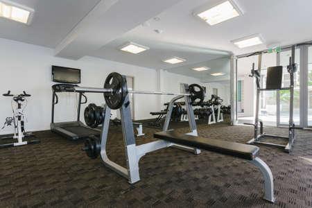Modern gym interior with equipment Stock Photo - 18573177