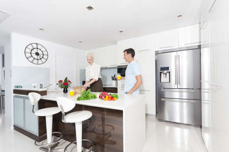 kitchen bench: Attractive young couple in modern kitchen
