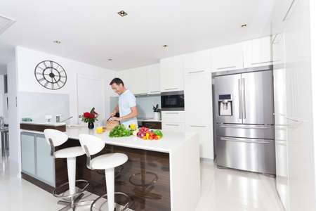 fridge: Hansome man in modern kitchen