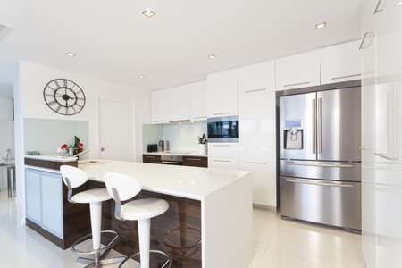 Modern kitchen in luxury house photo