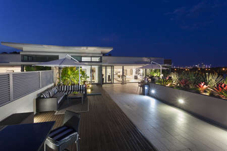 balcony view: Modern balcony at sunset in luxury penthouse