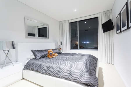 Modern bedroom in luxury apartment photo