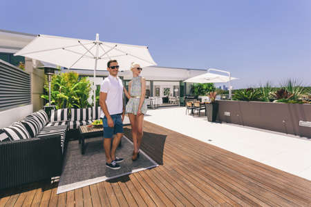 penthouse: Attractive couple on luxurious penthouse balcony