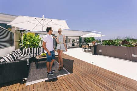 Attractive couple on luxurious penthouse balcony Stock Photo - 18937016