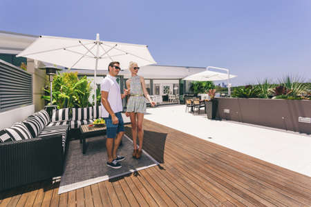 Attractive couple on luxurious penthouse balcony photo