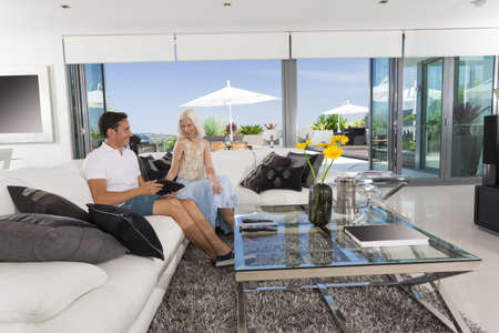 Young couple relaxing on couch in luxury living room