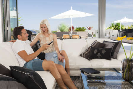 Young couple relaxing on couch in luxury living room Stock Photo - 18937063