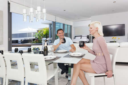 Attractive couple in luxury apartment photo
