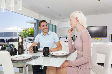 Attractive couple in luxury apartment Stock Photo - 18936984