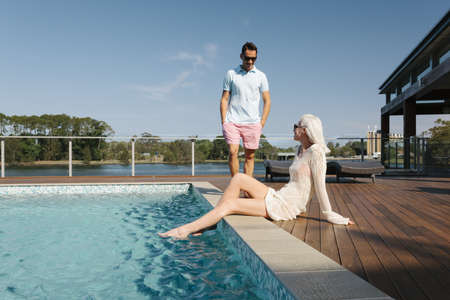 Sexy couple relaxing poolside Stock Photo - 18937094