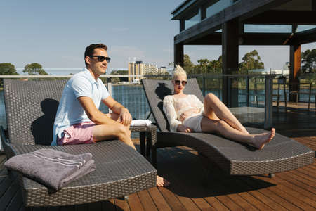 Sexy couple relaxing on sunbeds Stock Photo - 18937097