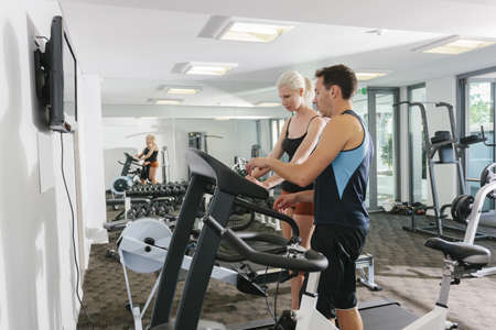 Attractive couple working out in gym photo