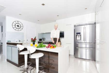 Attractive woman in modern kitchen Stock Photo - 18936954