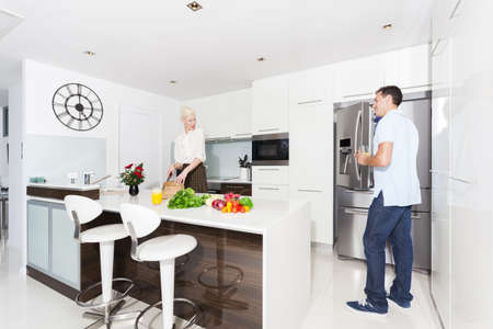 Attractive young couple in modern kitchen Stock Photo - 18936961