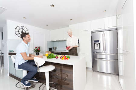 Attractive young couple in modern kitchen Stock Photo - 23090978