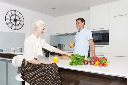 Attractive young couple in modern kitchen Stock Photo - 18936986