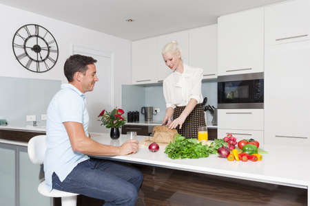 Attractive young couple in modern kitchen Stock Photo - 18936985