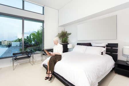master bedroom: Attractive woman in modern bedroom