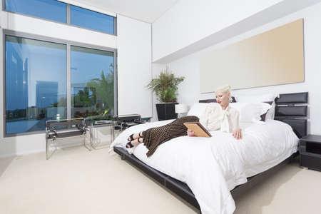 Attractive woman in modern bedroom