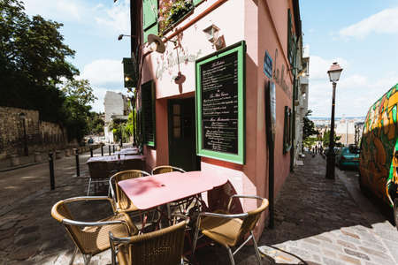 french cafe: Cafe resteraunt on the corner of a street in Paris