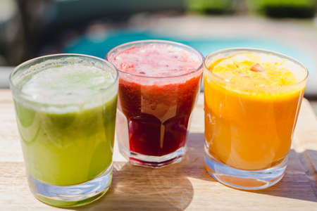 natural juices: 3 freshly pressed juices outside in sunlight