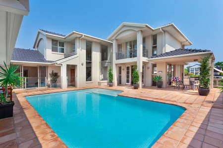 luxurious backyard with pool in modern australian mansion Stock Photo