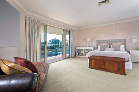 master bedroom: stylish master bedroom with balcony in australian mansion