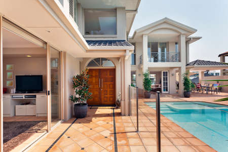 luxurious lifestyle: entry way to luxurious australian mansion with pool Stock Photo