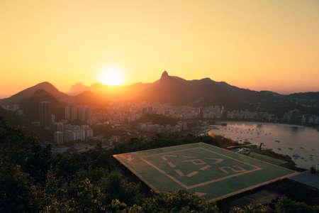 helipad: Sun setting over Rio de Janeiro with helipad in foreground