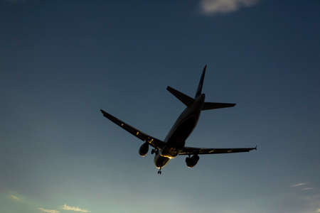 underneath: Airplane flying into Phoenix airport Editorial