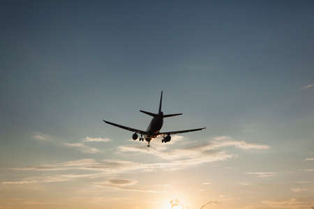 transportaion: Airplane landing in Phoenix with sunsetting