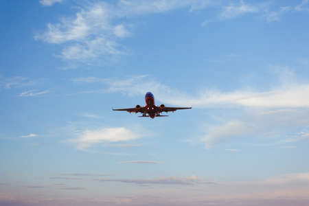transportaion: Airplane landing with pretty sky in background at dusk Editorial
