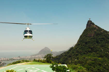 rio: Helicopter taking off with Corcovado in background
