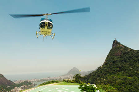 rio: Helicopter taking off in Corcovado with Christ The Redeemer statue in the background