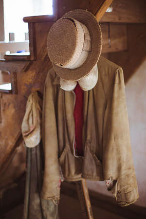Vintage Amish garments hanging from wooden stairs