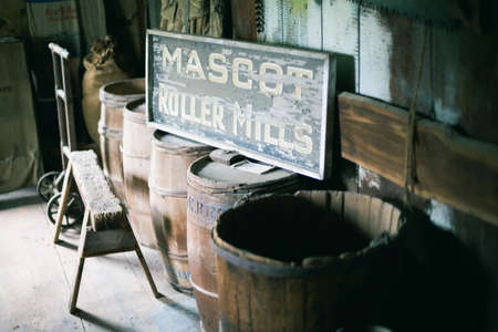 sawhorse: Vintage wodden barrels and sign