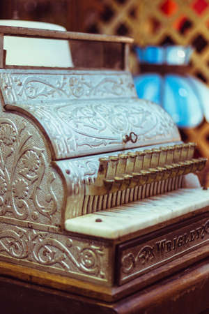 till: old fancy money till with baroque pattern